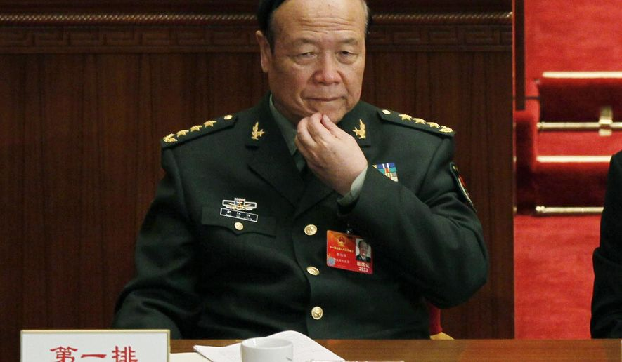 FILE - In this March 9, 2012 file photo, China's People's Liberation Army Gen. Guo Boxiong rubs his chin during a session of the National People's Congress in Beijing. The former top Chinese general will be tried in a military court on charges he took bribes, the county's military said Tuesday, April 5, 2016, in what is believed to be the highest-level prosecution of a military figure in decades. (AP Photo/Ng Han Guan,File)