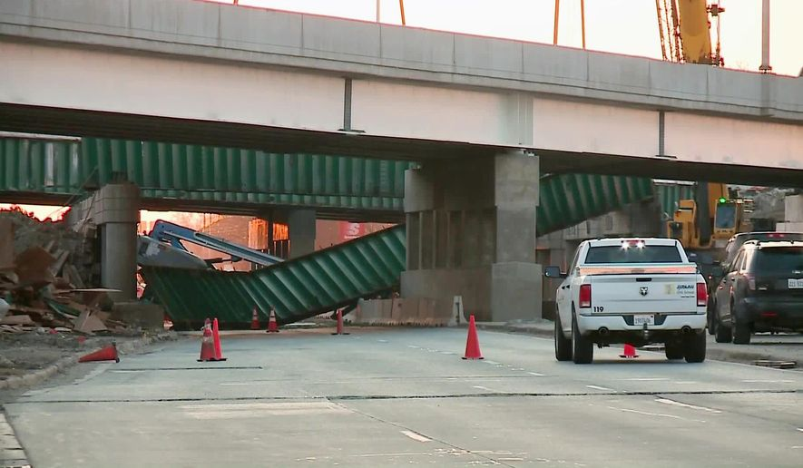 This frame from video by WGN-TV shows the aftermath of a deadly construction accident in Des Plaines, Ill., Tuesday, April 5, 2016. Workers were in lifts trying to remove the beam under Interstate 90 when it collapsed on them around 3 a.m. (WGN-TV via AP) TV OUT; MANDATORY CREDIT