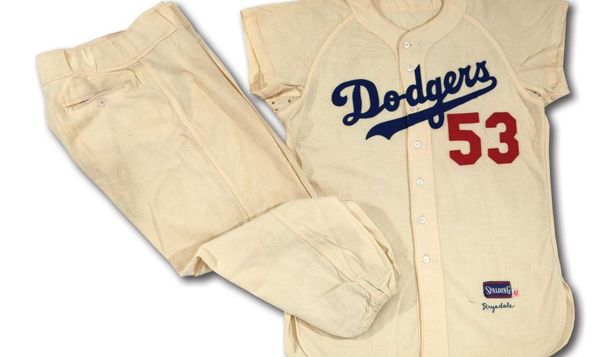 This undated photo provided by SCP Auctions shows former major league pitcher Don Drysdale's 1956 Brooklyn Dodgers home uniform. Ann Meyers Drysdale, the Hall of Fame basketball player who was married to the Hall of Fame pitcher, is putting the items up for auction starting Wednesday April 6. (Leslie Larsen Bird/SPC Auctions via AP)