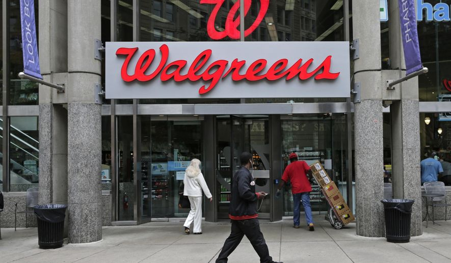 FILE - This June 4, 2014, file photo, shows a Walgreens retail store in Boston. On Tuesday, April 5, 2016, Walgreens reports financial results. (AP Photo/Charles Krupa, File)