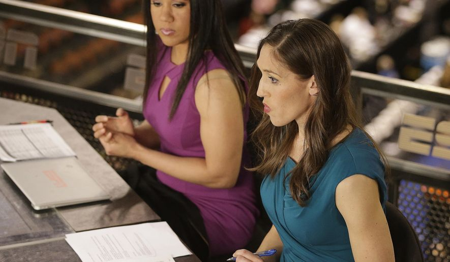 "In this Sunday, April 3, 2016 photo, Kara Lawson, left, and Rebecca Lobo prepare for a ESPN show before a national semifinal game at the women's Final Four in the NCAA college basketball tournament in Indianapolis. The witty banter that viewers see on-air is even more prevalent when the cameras stop rolling. ""Some of the best stuff happens when we're off camera,"" Lobo said. ""Kara would say something and we're like you got to use that on air."" (AP Photo/Darron Cummings)"