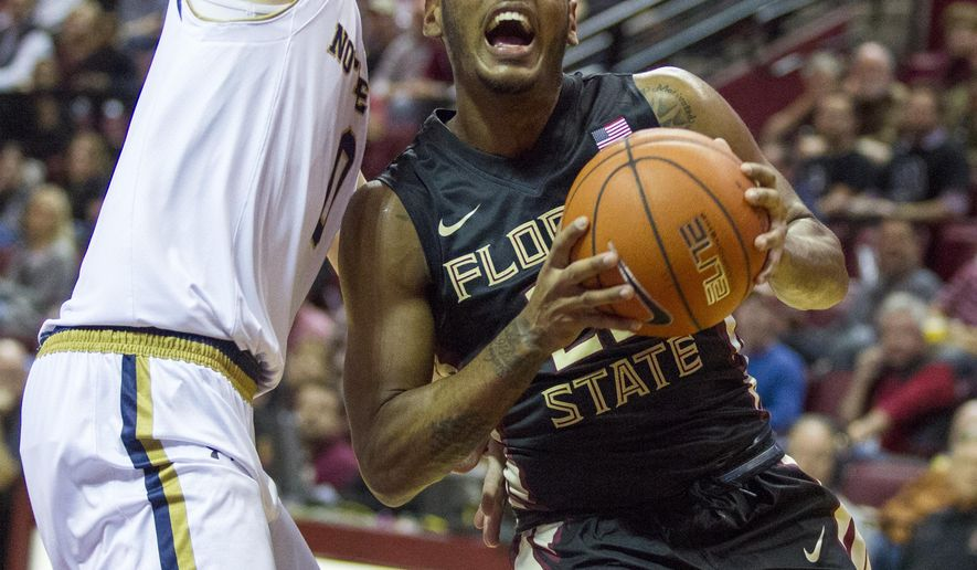 FILE - In this Saturday, Feb. 27, 2016 file photo, Florida State guard Xavier Rathan-Mayes (22) drives past Notre Dame guard Rex Pflueger, left, for a score in the first half of an NCAA college basketball game in Tallahassee, Fla. Florida State sophomore Xavier Rathan-Mayes will enter the NBA draft but not hire an agent, Tuesday, April 5, 2016. The 6-foot-4 guard is taking advantage of rule where he can attend team workouts and the pre-draft combine to assess his prospects without losing eligibility.(AP Photo/Mark Wallheiser, File)