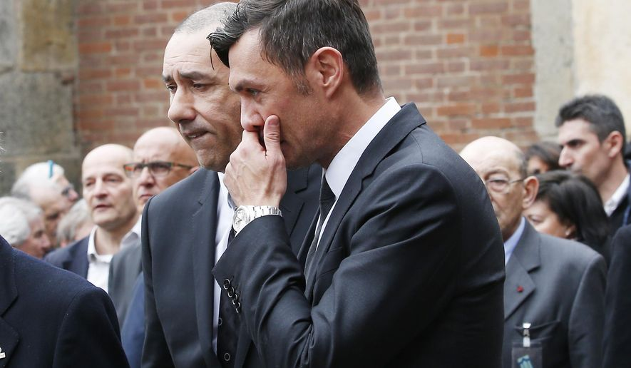 Paolo Maldini, right, former AC Milan captain, attends his father former Italy coach Cesare Maldini's funeral, in Milan's Sant'Ambrogio's Basilica, Italy, Tuesday, April 5, 2016. Cesare Maldini, who was also an AC Milan player and coach, died over the weekend at the age of 84.(AP Photo/Antonio Calanni)