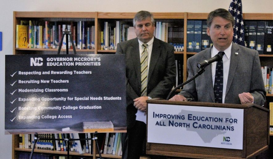 North Carolina Gov. Pat McCrory responds to a reporter's question during the unveiling of his education proposals for the state budget on Tuesday, April 5, 2016. McCrory, appearing at Ragsdale High School in Jamestown, North Carolina, also answered questions about the decision by PayPal to cancel plans to expand in Charlotte, North Carolina, in response to a new state law that restricts protections for lesbian, gay, bisexual and transgender people. (AP Photo/Skip Foreman)