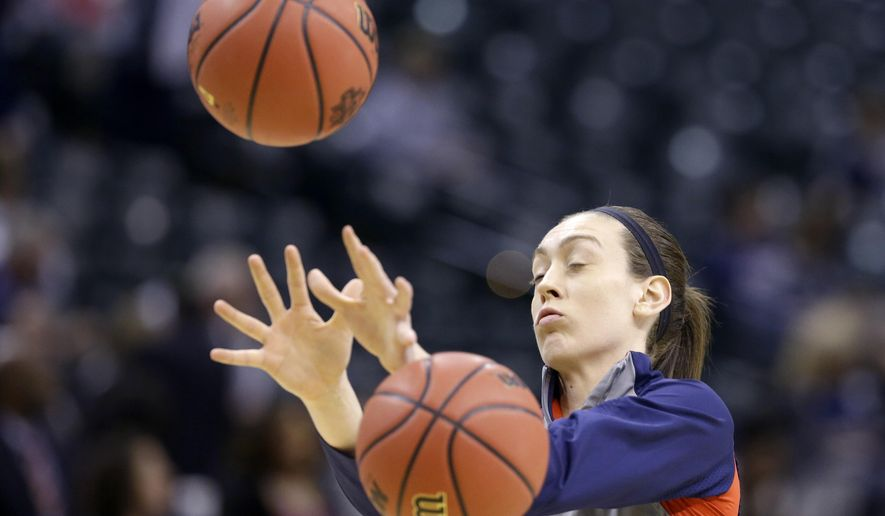 Connecticut's Breanna Stewart dodges basketballs as she warms-up before the championship game against Syracuse, at the women's Final Four in the NCAA college basketball tournament Tuesday, April 5, 2016, in Indianapolis. (AP Photo/Michael Conroy)