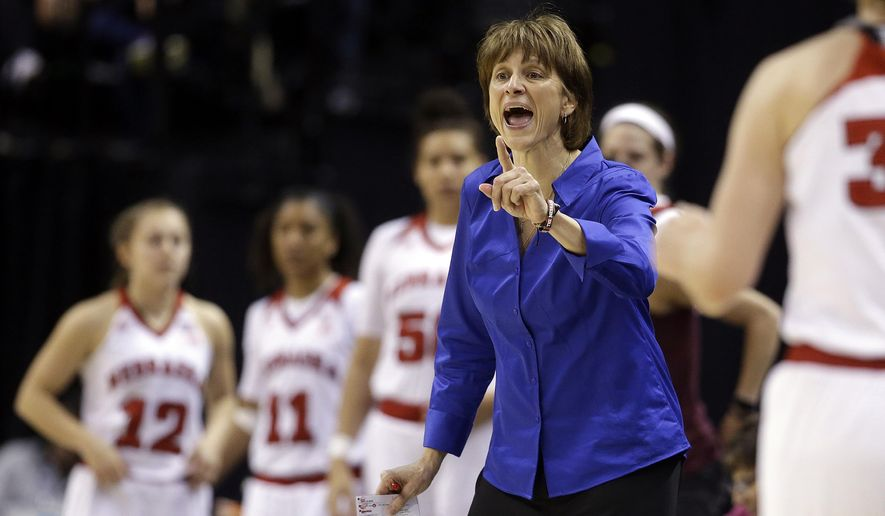 "FILE - In this March 3, 2016, file photo, Nebraska coach Connie Yori shouts instructions during the second half of an NCAA college basketball game against Rutgers at the Big Ten conference women's tournament in Indianapolis. Yori has resigned after 14 seasons at Nebraska, the school said in a statement Tuesday, April 5, 2016.  Yori said in the statement, that she had reached her decision following ""a difficult time in my life"" and thanked athletic director Shawn Eichorst for his support and leadership. (AP Photo/Darron Cummings, File)"