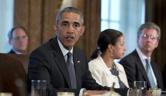 President Obama and National Security Adviser Susan Rice, second from right, speak during a meeting with Combatant Commanders and Joint Chiefs of Staff in the Cabinet Room of the White House in Washington, Tuesday, April 5, 2016. (Associated Press) ** FILE **
