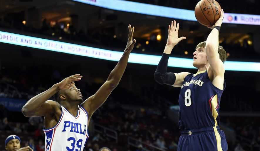 New Orleans Pelicans' Luke Babbitt (8) takes a shot over Philadelphia 76ers' Jerami Grant during the first half of an NBA basketball game, Tuesday, April 5, 2016, in Philadelphia. (AP Photo/Michael Perez)