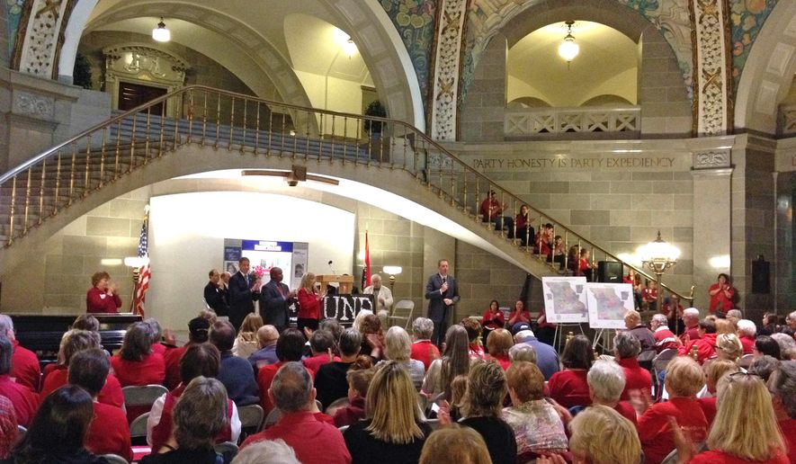 Missouri Republican Sen. Eric Schmitt speaks to a crowd of about 100 rallying against abortion on Tuesday, April 5, 2016, at the Missouri Capitol Rotunda in Jefferson City, Mo. Members of the state's top anti-abortion groups and other abortion opponents gathered to call to defund Planned Parenthood. (AP Photo/Summer Ballentine)