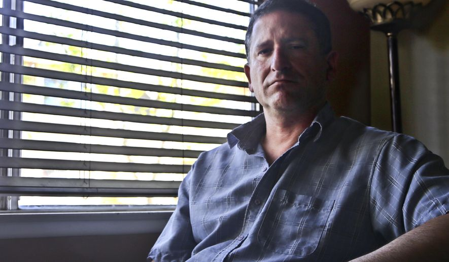 In this photo taken March 24, 2016, Keith Gartenlaub is seen at his home in Southern California. FBI agents investigating a potential data leak at Boeing obtained a secret warrant to search the home computers of Gartenlaub, a company manager in California, for evidence they hoped would connect him to Chinese economic espionage.  (AP Photo/Lenny Ignelzi)