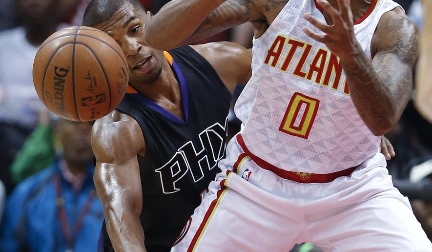 Atlanta Hawks guard Jeff Teague (0) has the ball knocked away by Phoenix Suns guard Ronnie Price during the first half of an NBA game Tuesday, April 5, 2016, in Atlanta. (AP Photo/John Bazemore)