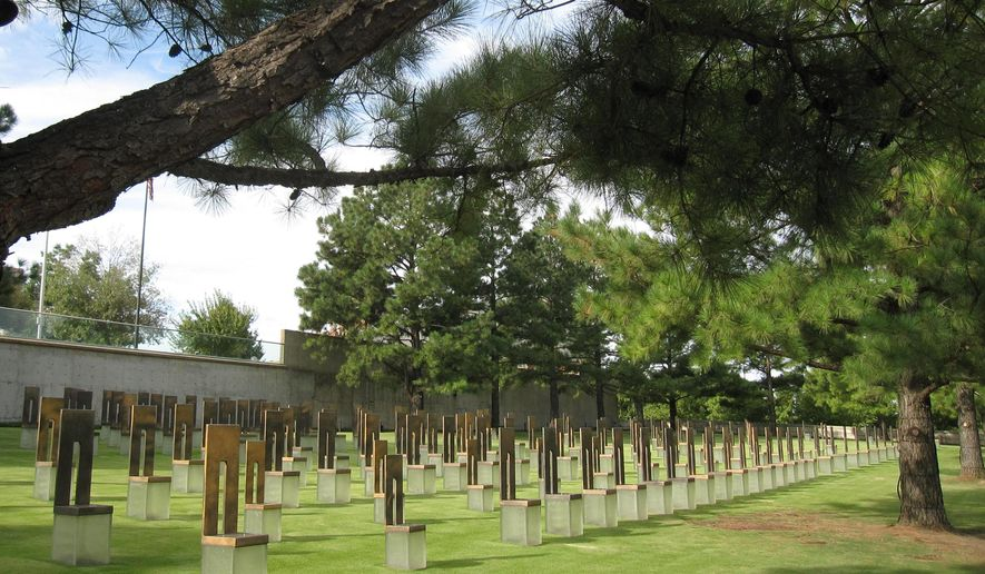 This Sept. 24, 2014 photo shows the field of empty chairs at the Oklahoma City National Memorial. Each of the 168 chairs represents someone who died in the April 19, 1995 bombing, which destroyed the Alfred P. Murrah Federal Building. The memorial is built where the building once stood. (AP Photo/Beth J. Harpaz)