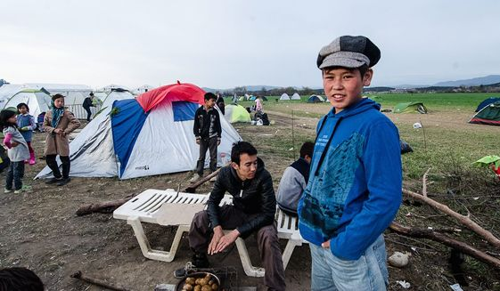 Young Afghan refugees are left in limbo on the Greek-Macedonia border, where a makeshift refugee camp is struggling to handle the estimated 14,000 people stranded after Macedonia announced it would close its border with Greece. (Valerie Plesch/Special to the Washington Times)