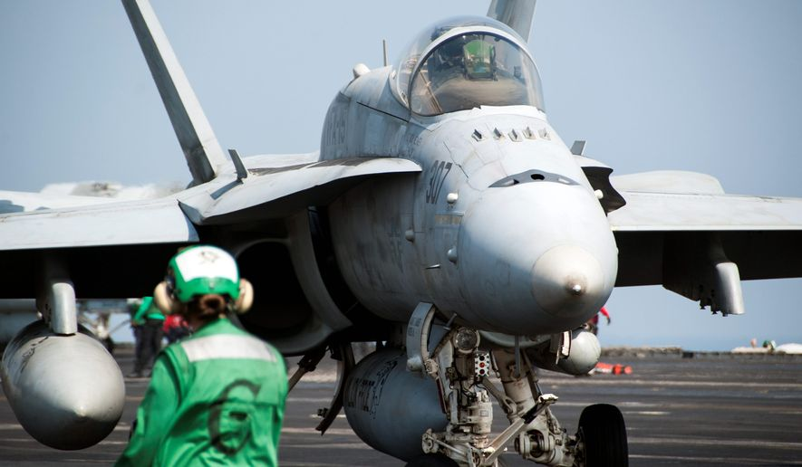 A war planner at the Pentagon said Islamic State fighters are losing land and are restricted in maneuvers on the battlefield as coalition precision airstrikes destroy vehicles, locations and munitions. (U.S. Navy)