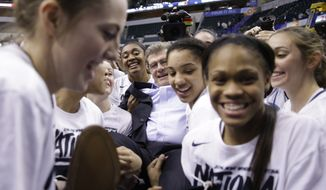 Connecticut head coach Geno Auriemma is carried off the court by members of his team after defeating Syracuse 82-51in the championship game at the women's Final Four in the NCAA college basketball tournament Tuesday, April 5, 2016, in Indianapolis. (AP Photo/AJ Mast)