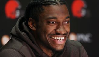 Cleveland Browns quarterback Robert Griffin III answers a question during a news conference at the NFL football teams practice facility Wednesday, April 6, 2016, in Berea, Ohio. (AP Photo/Ron Schwane)