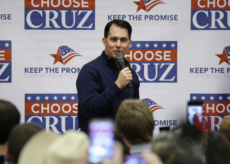 In this April 3, 2016, file photo, Wisconsin Gov. Scott Walker introduces Republican presidential candidate Sen. Ted Cruz, R-Texas, in Eau Claire, Wis. (AP Photo/Nam Y. Huh, File)