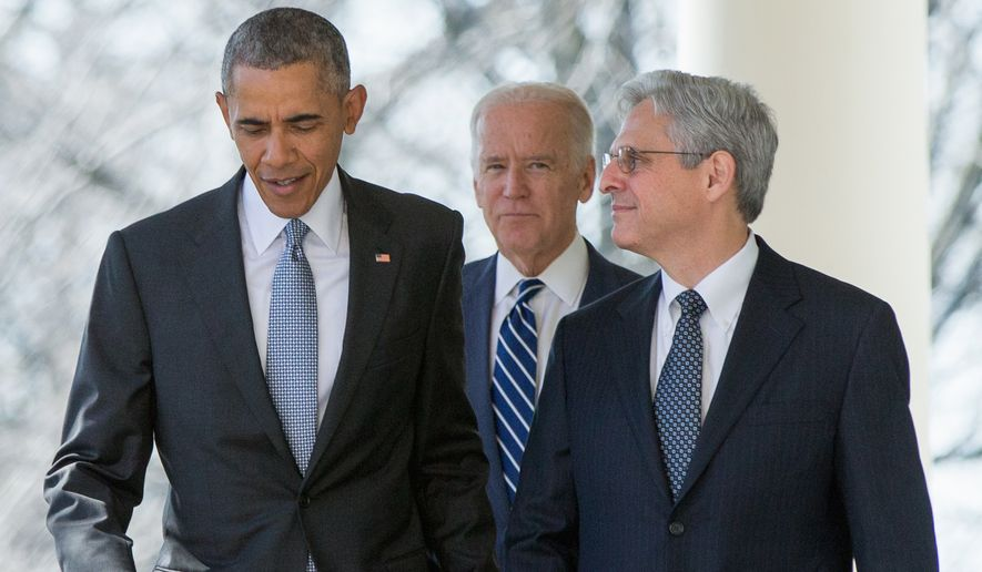 In this photo taken March 16, 2016, Federal appeals court Judge Merrick Garland arrives with President Barack Obama and Vice President Joe Biden to be introduced as Obama's nominee for the Supreme Court, during an announcement in the Rose Garden of the White House, in Washington. Garland, has been characterized as a moderate who, if confirmed, would nudge his divided colleagues slightly to the left because he would replace conservative stalwart Antonin Scalia. (AP Photo/Andrew Harnik, File)