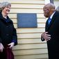 Harvard President Drew Faust, left, and Congressman John Lewis unveil a plaque at Harvard's Wadsworth House honoring four slaves that had been owned by and worked for Harvard's past presidents in the university's Wadsworth House house in Cambridge, Mass., Wednesday, April 6, 2016. (Keith Bedford /The Boston Globe via AP)