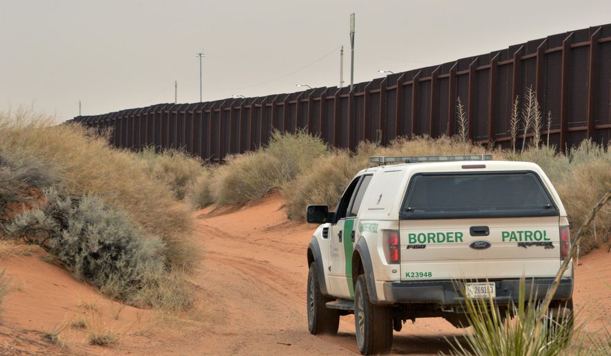 FILE - In this Jan. 4, 2016 file photo, a U.S. Border Patrol agent drives near the U.S.-Mexico border fence in Santa Teresa, N.M. A new complaint says U.S. Border Patrol agents are looting immigrants of possessions before deporting them to Mexico without their IDs or money. The ACLU of New Mexico and a coalition of advocacy groups filed the administrative complaint with the U.S. Department of Homeland Security on Wednesday, April 6, 2016, and say the seizures are endangering migrants at the U.S.-Mexico border. (AP Photo/Russell Contreras, File)