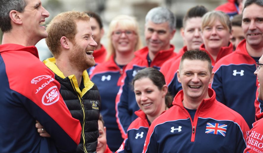 Britain's Prince Harry, 2nd left, unveils the UK team for the upcoming Invictus Games 2016, at Buckingham Palace in London Wednesday April 6, 2016.  Prince Harry joined the military veterans and serving men and women athletes selected for the Paralympics-style sporting spectacle to be held in Florida, USA, in May 2016. (Jeremy Selwin/pool via AP)