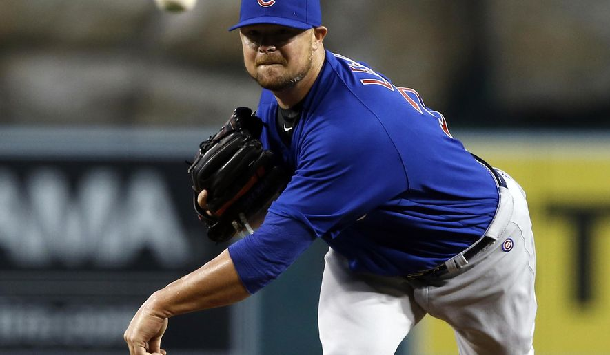 Chicago Cubs starting pitcher Jon Lester throws against the Los Angeles Angels during the first inning of a baseball game in Anaheim, Calif., Tuesday, April 5, 2016. (AP Photo/Alex Gallardo)