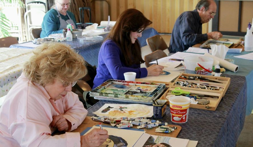 ADVANCE FOR USE SUNDAY, APRIL 10 AND THEREAFTER - In this March 19, 2016 photo, Sullivan Art Club members attempt to recreate a watercolor painting of a Mediterranean man with a weathered face at a workshop at Saint Collumcille Church Hall in Sullivan, Ill. Because watercolor dries quickly, the painting style proves challenging, especially handling portraits, which have to be particularly accurate. (Jarad Jarmon/Journal Gazette via AP) MANDATORY CREDIT