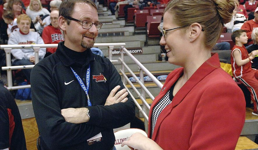 ADVANCE FOR USE SATURDAY, APRIL 9 AND THEREAFTER - In this Jan. 6, 2016 photo, Keith Smith, left, the operations manager for the Illinois State University athletic department, talks with L.B. Lyons, assistant athletic director/marketing, during halftime of the ISU-Bradley basketball game in Normal, Ill. Smith's job is to make sure everything goes off without a hitch. He supervises a staff of seven full-time and 40 student workers who prepare venues for various athletic events. (Lori Ann Cook-Neisler/The Pantagraph via AP)  MANDATORY CREDIT
