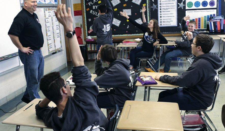 ADVANCE FOR USE SATURDAY, APRIL 9 AND THEREAFTER - In this March 4, 2016 photo, Jeff Grove, the mayor of La Salle, Ill., fields questions from eighth-grade American history students at Trinity Catholic School in La Salle. Grove explained La Salle government to the 16 students in the class. (Chris Yucus/NewsTribune via AP)  MANDATORY CREDIT