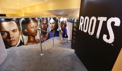 """View of the stand of the new tv series """"Roots"""" at the MIPTV, International Television Programme Market, Monday, April 4, 2016, in Cannes, southern France.(AP Photo/Lionel Cironneau)"""