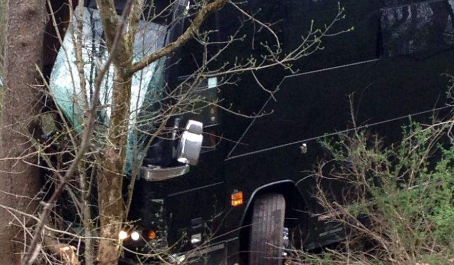 A tour bus for musician Gregg Allman's band rests against a tree near a creek after veering off Interstate 77 Wednesday morning, April 6, 2016, near Goldtown, W.Va. A tour spokesman for Allman's band says three crew members have been injured. The bus was headed to a concert Wednesday at the Clay Center in Charleston, about 20 miles south of Goldtown. Clay Center spokeswoman LeAnn Cain said the concert is still on. Allman wasn't on the bus.  (Brooke Thibodaux/WCHS-TV via AP) CHARLESTON (W.VA.) OUT