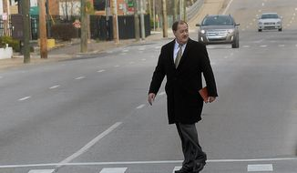 Former Massey Energy CEO Don Blankenship makes his way across Virginia Street in Charleston, W.V., before entering the Robert C. Byrd Federal Courthouse for his sentencing on Wednesday, April 6, 2016. (F. Brian Ferguson/The Gazette-Mail via AP)