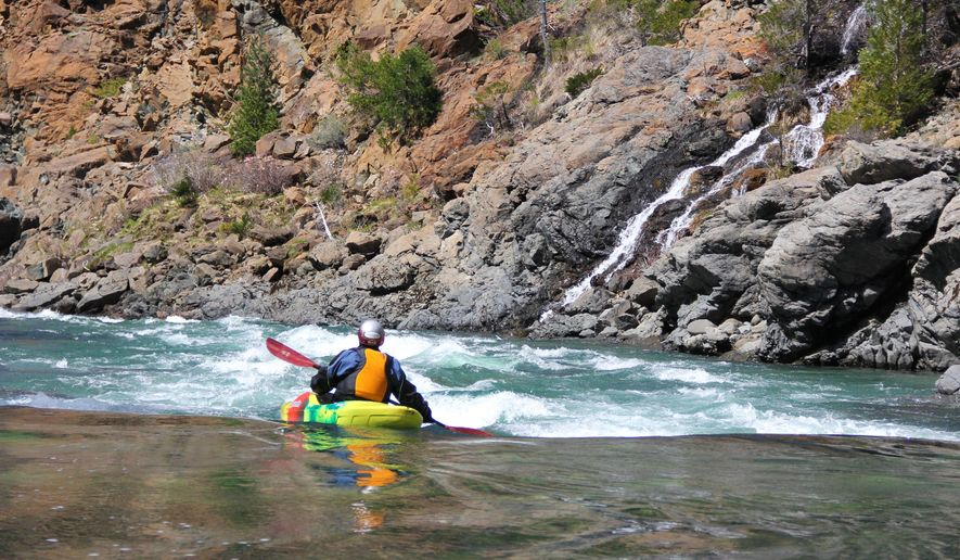 """ADVANCE FOR THE WEEKEND OF APRIL 9-10 AND THEREAFTER -  Peter Gandesbery of Ashland kayaks through """"waterfall ally"""" on the North Fork of the Smith River in northwest California. The North Fork Smith is a blade of jade-green water cutting through the remote heart of the Klamath-Siskiyou Mountains. While famous among hard-core kayakers and rafters, it remains generally unknown to the Northwest populace.  (Zach Urness/Statesman-Journal via AP) MANDATORY CREDIT"""