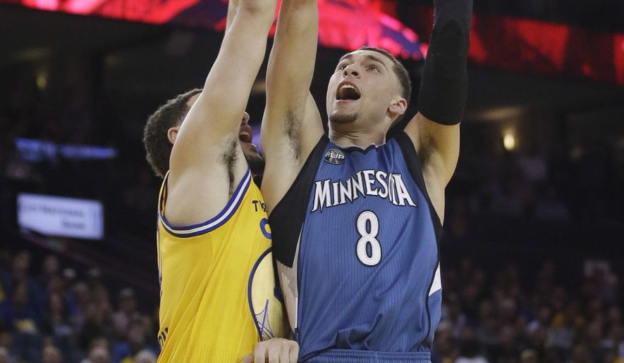 Minnesota Timberwolves' Zach LaVine (8) drives to the basket as Golden State Warriors' Klay Thompson defends during the first half of an NBA basketball game Tuesday, April 5, 2016, in Oakland, Calif. (AP Photo/Marcio Jose Sanchez)
