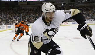 Pittsburgh Penguins' Eric Fehr (16) plays against the Philadelphia Flyers in an NHL hockey game, Sunday, April 3, 2016 in Pittsburgh. (AP Photo/Keith Srakocic)