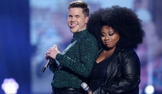 Trent Harmon was crowned Thursday as Fox TV's singing contest ended its 15-season run. The runner-up was La'Porsha Renae. (Associated Press)