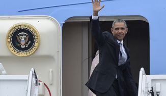 President Barack Obama waves from the top of the steps of Air Force One at Andrews Air Force Base in Md., Thursday, April 7, 2016. Obama is traveling to Chicago and then to California. (AP Photo/Susan Walsh)