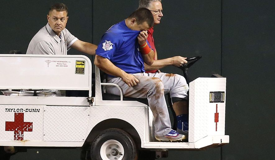 An injured Chicago Cubs' Kyle Schwarber, front, is taken off the field during the second inning of a baseball game against the Arizona Diamondbacks Thursday, April 7, 2016, in Phoenix. (AP Photo/Ross D. Franklin)