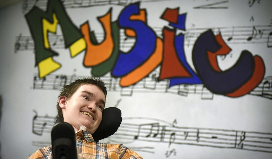 In this Thursday, March 17, 2016, Swanville High School student Ethan Och, talks about his experiences in band, pep band and marching band despite a battle with spinal muscular atrophy in Swanville, Minn. Och and his former music teacher Gina Christoperson have been named recipients of the National Federation of High Schools' Heart of the Arts award for Section 5, which includes Minnesota, North Dakota, South Dakota, Nebraska, Kansas and Missouri. (Dave Schwarz/St. Cloud Times via AP)  NO SALES; MANDATORY CREDIT