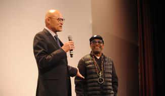 """Interim UM Systems President Mike Middleton, left, introduces filmmaker Spike Lee before the premiere of """"2 Fists Up"""", Spike Lee's documentary about protests at the University of Missouri, at the Missouri Theatre on Wednesday, April 6, 2016, in Columbia, Mo. Lee worked with ESPN to make the documentary, which examines how the Black Lives Matter movement sparked activism at the University of Missouri. (Mikala Compton/Missourian via AP) MANDATORY CREDIT"""