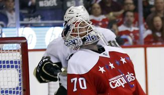 Washington Capitals goalie Braden Holtby (70) reacts after a goal by Pittsburgh Penguins left wing Conor Sheary in the second period of an NHL hockey game, Thursday, April 7, 2016, in Washington. (AP Photo/Alex Brandon)