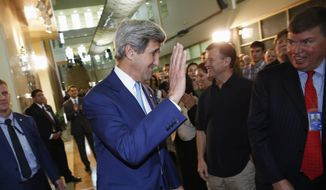 Secretary of State John Kerry acknowledges applause from U.S. Embassy staff members as he arrives to speak in Baghdad, Friday, April 8, 2016.  (Jonathan Ernst/Pool Photo via AP)