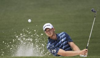 Daniel Berger hits from a bunker on the second hole during the second round of the Masters golf tournament Friday, April 8, 2016, in Augusta, Ga. (AP Photo/Jae C. Hong)