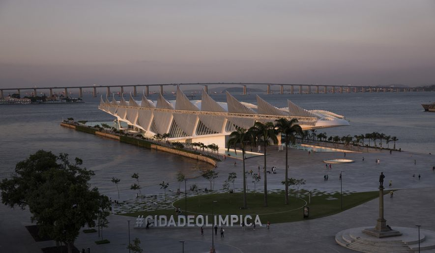"""The Museum of Tomorrow is lit by the setting sun in the renovated Praca Maua, in the port area of Rio de Janeiro, Brazil, Thursday, April 7, 2016. The United States men's and women's basketball teams will be staying on a cruise ship in the harbor during the Olympics. The NBA is also expected to set up a """"hospitality house"""" in the port area. (AP Photo/Felipe Dana)"""