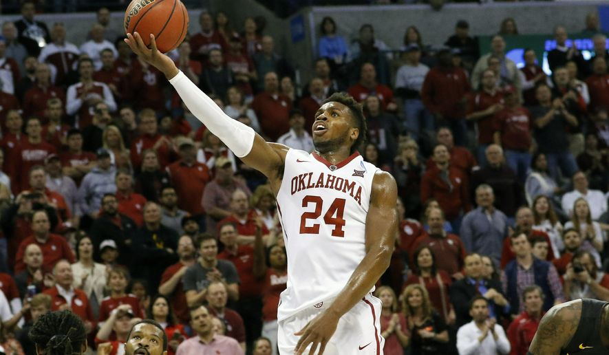 FILE - In this Sunday, March 20, 2016 file photo, Oklahoma guard Buddy Hield (24) goes up for a basket against VCU in the second half during a second-round men's college basketball game in the NCAA Tournament in Oklahoma City.  Buddy Hield of Oklahoma and Breanna Stewart of four-time national champion Connecticut won the John R. Wooden Award as national college basketball players of the year Friday night, April 8, 2016.  (AP Photo/Alonzo Adams, File)