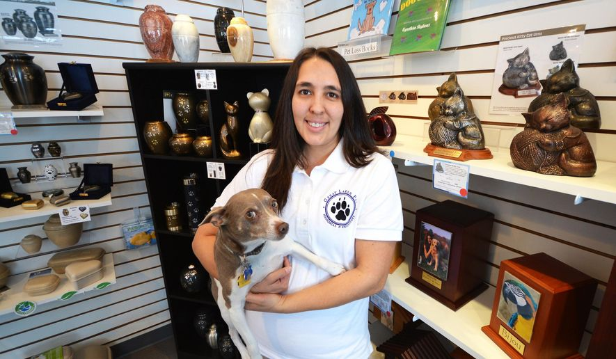 ADVANCED FOR RELEASE SUNDAY, APRIL 10, 2016 Kerri Collier owns Great Lakes Pet Memorial, a Traverse City, Mich. company that offers pet cremation services and memorial products. (Dan Nielsen/Traverse City Record-Eagle via AP)