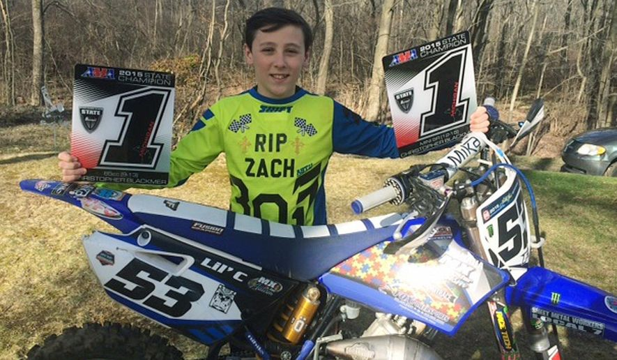 ADVANCE FOR MONDAY, APRIL 11, AND THEREAFTER- In a March 28, 2016 photo Christopher Blackmer stands next to his motocross bike in Fruitport, Mich. Blackmer, a 13-year-old that attends Fruitport Middle School, has become a multiple winner of state titles on the American Motorcyclist Association motocross circuit. He's already got nearly nine years of racing experience despite his young age. For the 2015 season, Christopher totaled four championships, including a national Ice Racer of the Year honor in the 85cc class. (Mark Opfermann/The Muskegon Chronicle-Mlive.com via AP)