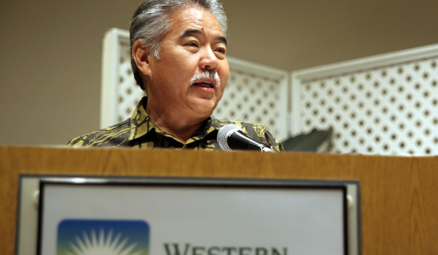 In this Thursday, April 7, 2016 photo, Hawaii Gov. David Ige speaks at workshop held by the non-partisan Western Governor's Association in Honolulu, addressing Wyoming Gov. Matt Mead's Species Conservation and Endangered Species Act Initiative. Ige was joined by officials from the Hawaii Board of Land and Natural Resources, California Natural Resources Agency, National Oceanic and Atmospheric Administration and the U.S. Fish and Wildlife Service to talk about how to better protect endangered plants and animals. (AP Photo/Marina Riker)