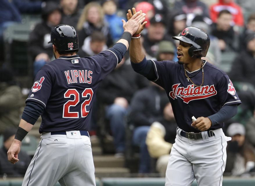 Cleveland Indians' Francisco Lindor, right, celebrates with Jason Kipnis after scoring on a fielder's choice by Carlos Santana during the first inning of a baseball game against the Chicago White Sox, Friday, April 8, 2016, in Chicago. (AP Photo/Nam Y. Huh)