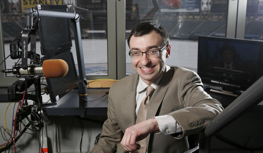 In this Monday Jan. 11, 2016 photo, New White Sox announcer Jason Benetti poses in his chair at U.S. Cellular Field in Chicago. In just a decade, Jason Benetti has gone from intense student at Syracuse University to the television broadcast booth calling Chicago White Sox games. Benetti, who has cerebral palsy, is a role model for people with disabilities and figures his broadcasting career can serve as an inspiration.(Michael Tercha/Chicago Tribune via AP) MANDATORY CREDIT CHICAGO TRIBUNE; CHICAGO SUN-TIMES OUT; DAILY HERALD OUT; NORTHWEST HERALD OUT; THE HERALD-NEWS OUT; DAILY CHRONICLE OUT; THE TIMES OF NORTHWEST INDIANA OUT; TV OUT; MAGS OUT; NO SALES